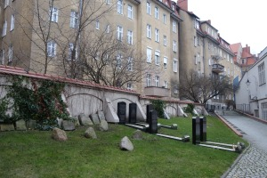Commemorative graves and old tombstones recovered around the city. The apartments overlooking the site were built just outside the cemetery walls in the early 20th century.