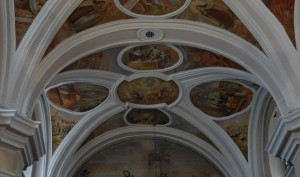 Frescos over the alter depicting the profaning of the host
