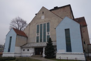 "The exterior of the former ""new"" synagogue in Poznan. The words ""Pływalnia Miejska"" (City Pool) can be made out above the long windows. The pool was closed just three years ago in 2011."