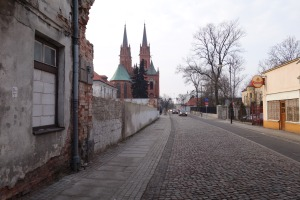 A wall stands where 15 Tumska Street used to be. The cathedral is in the background.
