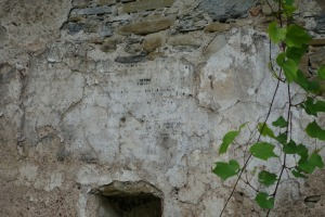 Writing still visible on the wall of the ruined synagogue in Dukla