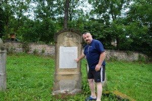 Jacek reading a tombstone in the new Jewish cemetery, Dukla