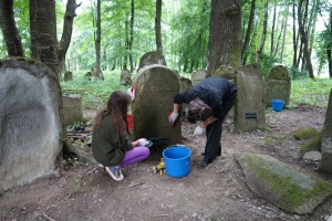Local residents help clean the tombstones in Lesko
