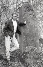 Marcin beside a tombstone taller than he is. 1992