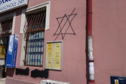 Star of David crossed out--on a storefront in Podgórze