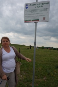Bożena showing me the new sign at the Jewish cemetery in Kutno