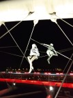 Sculptures of acrobats suspended on wires, by Jerzy Kendziora.